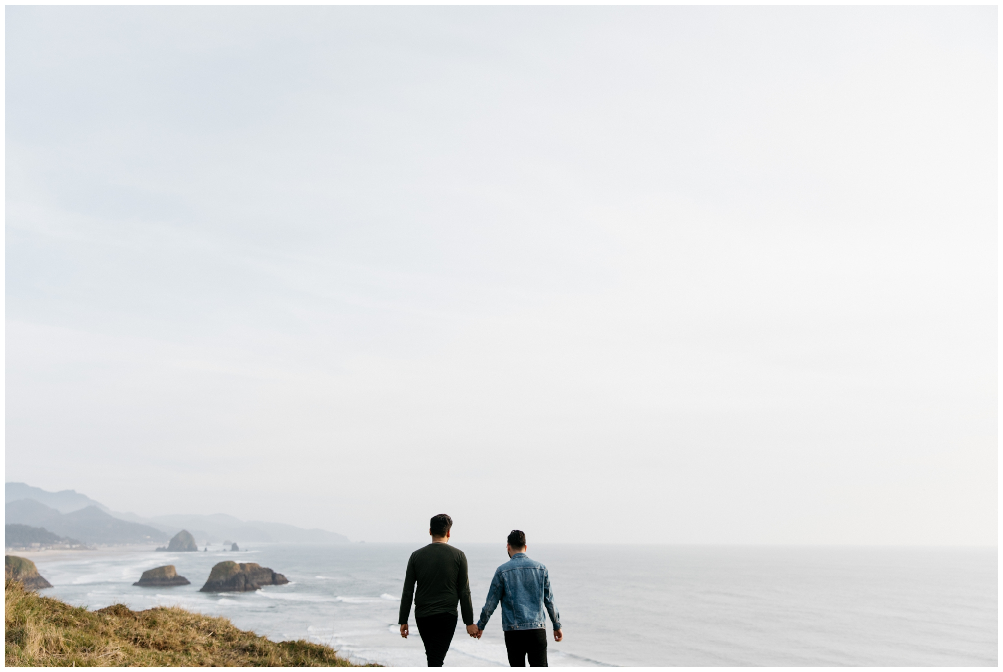Cannon Beach Engagement With Brittney Hyatt Photography Seattle Wedding and Elopement Photographer. Same-sex couple proposes to each other at Ecola State Park on a cliff side overlooking Cannon Beach.